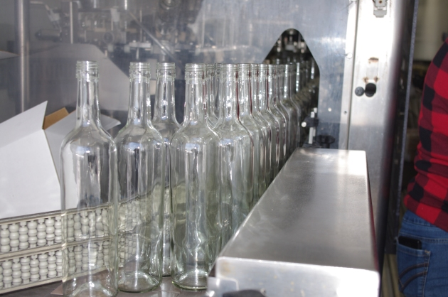 The bottles march in one by one